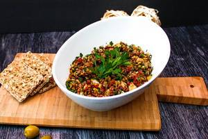 Food Photo of Green Olive Tapenade Paste in White Bowl with Wholemeal Crisp Bread on Wooden Cutting Board