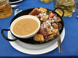 Food Photo of Pan with Sweet Dessert Kaiserschmarrn with Apple Sauce at Oktoberfest in Munich, Germany