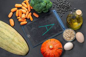 Foods with lots of vitamin A on a black background. View from above (Flip 2019)