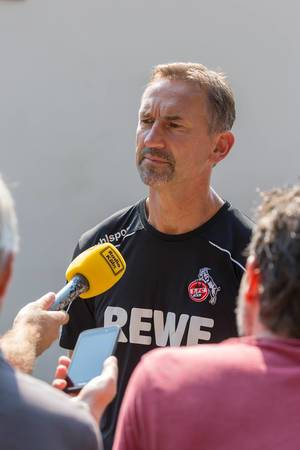 Football coach Achim Beierlorzer talks to the press after training his team