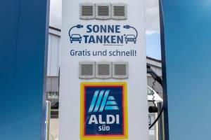For more sustainability: free electric charging station, usable during sun hours, for e-bikes on an Aldi-Süd parking lot