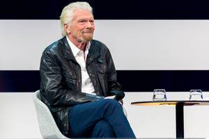 Founder and Investor Richard Branson on stage in the talk at Digital X in Cologne