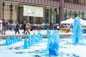 Fountain at City Market in Chicago with blue colored water