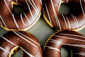 Four chocolate glazed doughnuts
