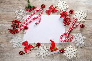 Frame of Christmas decor and white snowflakes on wooden background with free space (Flip 2019)