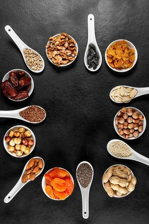 Frame of healthy food products-dried fruits, nuts and seeds, top view (Flip 2020)