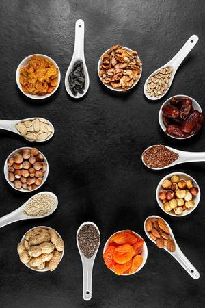 Frame of healthy food products-dried fruits, nuts and seeds, top view