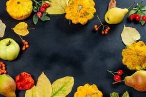 Frame with yellow leaves, fruits, vegetables and berries on black background with free space (Flip 2019)