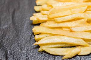 French fries on black background  Flip 2019