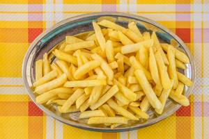 French fries on metal plate