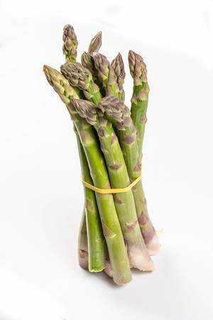 Fresh Asparagus above white background (Flip 2019)