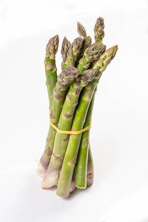 Fresh Asparagus above white background