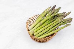 Fresh Asparagus in the basket with copy space