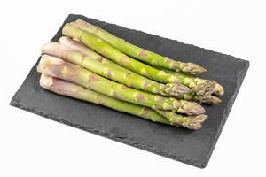 Fresh Asparagus on the black stone tray (Flip 2019)