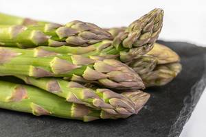 Fresh Asparagus on the black tray (Flip 2019)