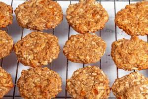 Fresh baked chip oatmeal cookies on metal rack (Flip 2019)