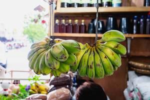 Fresh bananas hanging at a convenient store