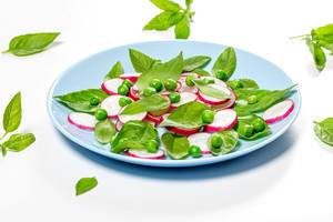Fresh Basil leaves and radishes on a blue plate (Flip 2019)