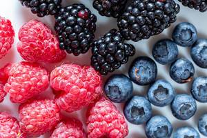 Fresh blueberries, raspberries and mulberries