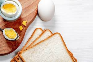 Fresh boiled chicken eggs and toast bread