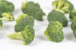 Fresh Broccoli on the white table (Flip 2020)