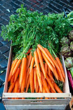 Fresh carrots at a vegetable market in Rom, Italy