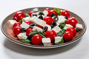 Fresh diet salad with olives, Basil, tomatoes and feta cheese