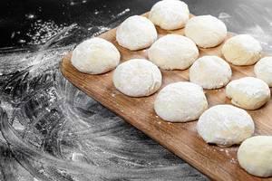 Fresh dough on a wooden kitchen Board (Flip 2019)