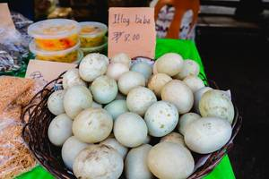 Fresh duck eggs on basket