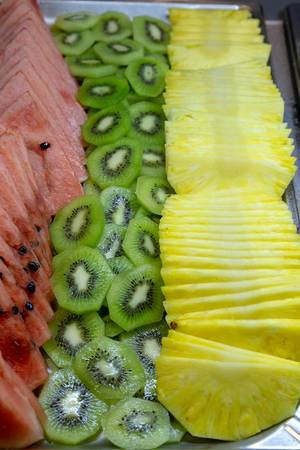 Fresh fruit at a buffet - pineapple, kiwi and watermelone
