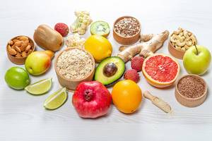 Fresh fruit, nuts, seeds and oatmeal. Healthy food background (Flip 2019)