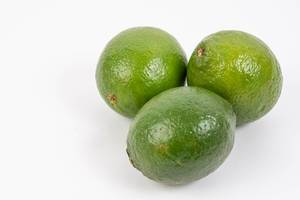 Fresh Green Limes on the white background