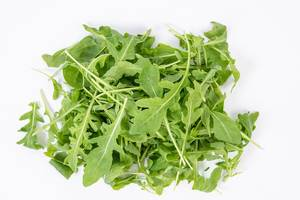 Fresh Healthy Green Rucola above white background (Flip 2019)