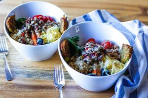 Fresh Healthy Salad With Quinoa, Tomatoes, Olives and Dressing