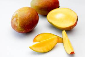 Fresh Mango on a White Background Close-Up
