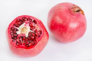 Fresh Pomegranate isolated above white background