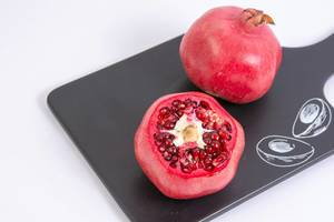 Fresh Pomegranate on the black tray