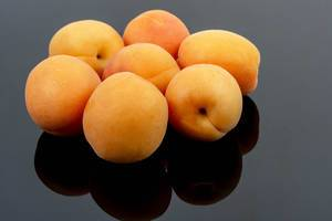 Fresh raw Apricots on the black background (Flip 2019)