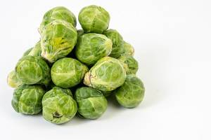 Fresh raw healthy Brussel Sprouts above white background (Flip 2019)