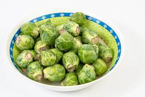 Fresh raw healthy Brussel Sprouts in the bowl (Flip 2019)