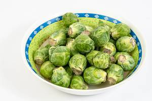 Fresh raw healthy Brussel Sprouts in the bowl