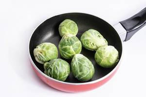 Fresh raw healthy Brussel Sprouts in the frying pan