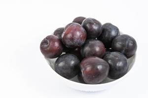 Fresh Raw Plums isolated above white background (Flip 2019) (Flip 2019) (Flip 2019)