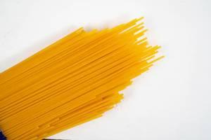 Fresh Raw Spagheti above white background (Flip 2020)