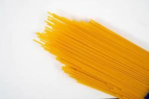 Fresh Raw Spagheti above white background