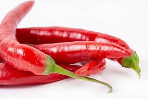Fresh Red Hot Chilli Peppers above white background (Flip 2019)