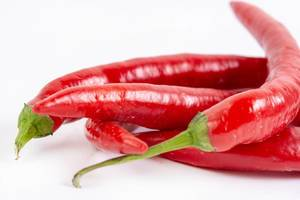 Fresh Red Hot Chilli Peppers above white background