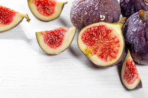 Fresh, ripe figs with water drops