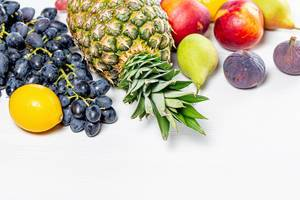 Fresh ripe fruit on white background. The concept of vitamins, healthy foods (Flip 2019)