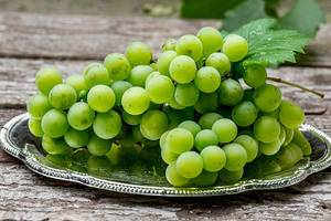 Fresh ripe green grapes on a silver tray